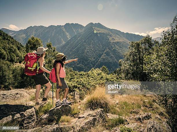 Woman and child trekking in the mountains