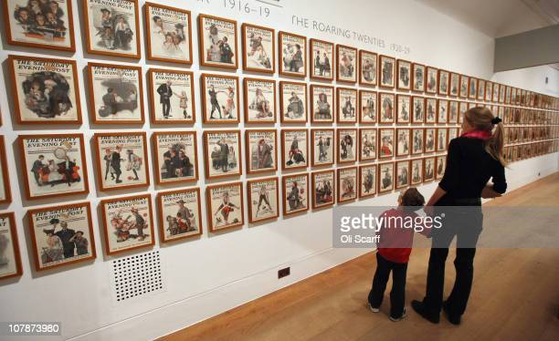 A woman and child view magazine front covers drawn by American Norman Rockwell in Dulwich Picture Gallery which celebrates its bicentenary this year...