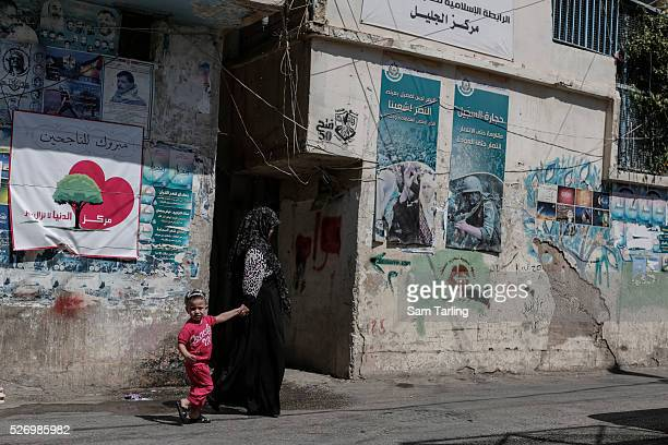 A woman and child walk through the Galilee Palestinian refugee camp in Baalbek Lebanon on July 23 2105 Until 2010 the camp was home to Reem Sawhil...