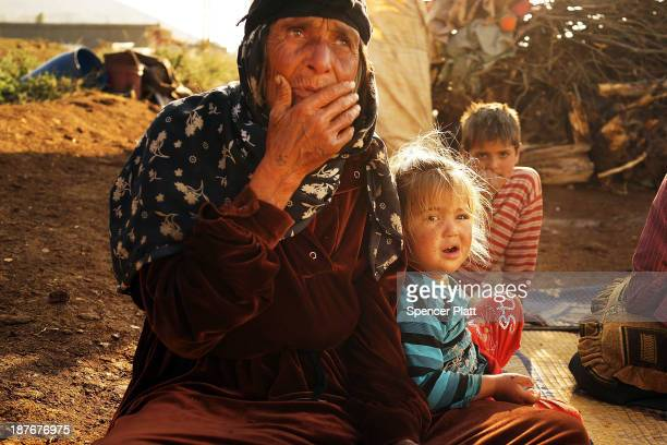 A woman and child who recently arrived from the besieged Syrian city of Aleppo pause in a makeshift camp in the Bekaa Valley close to the border with...