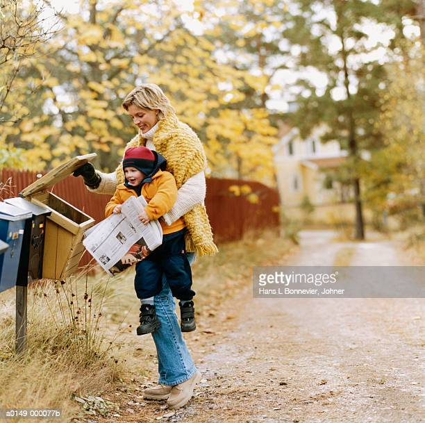 Woman and Child with Newspaper