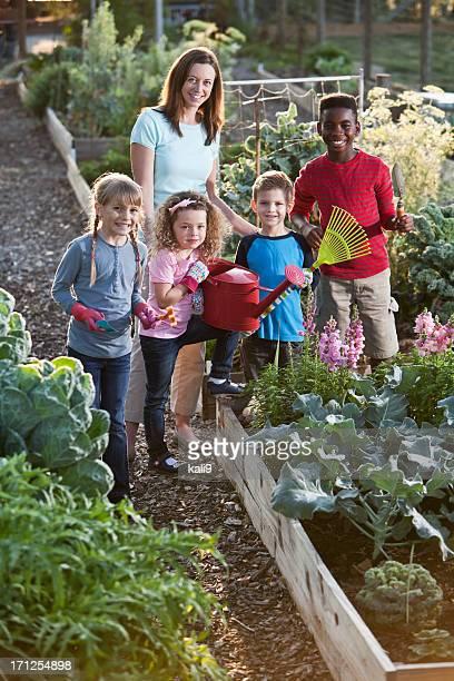 Woman and children at community garden