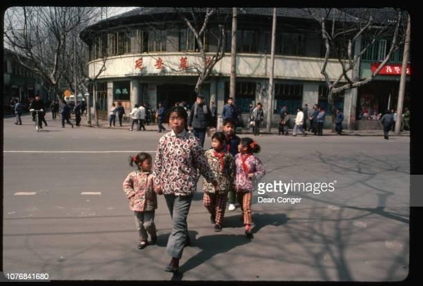 Woman and Children Cross Street in Hangzhou