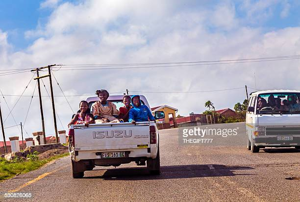 woman and children on a pick up in south africa - eastern cape stock pictures, royalty-free photos & images