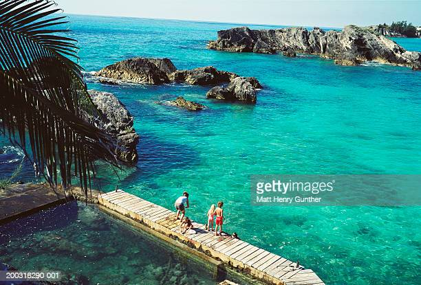 woman and children (5-10) on jetty, elevated view - bermuda stock pictures, royalty-free photos & images