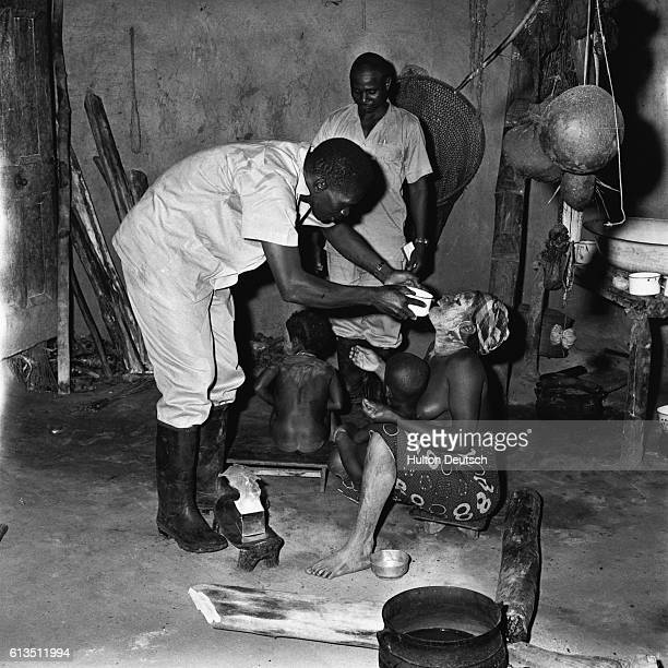 Woman and children treated bywithchdoctors in Liberia 1958