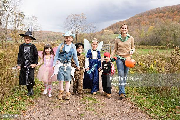 Woman and children trick or treating