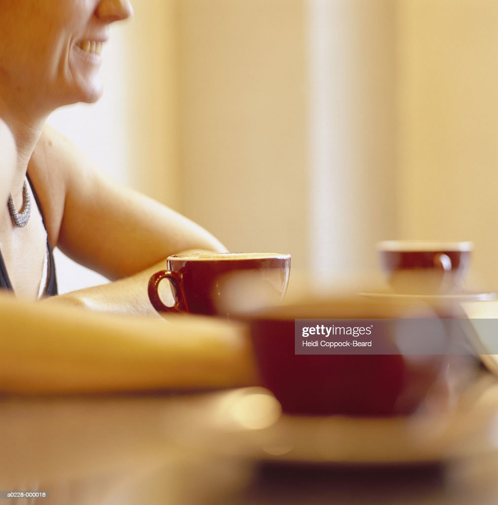 Woman and Coffee Cups : Stock Photo