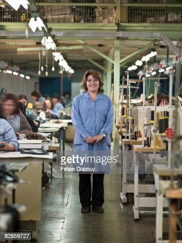 Woman and coworkers in factory