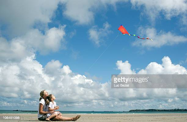 Woman and daughter flying a kite