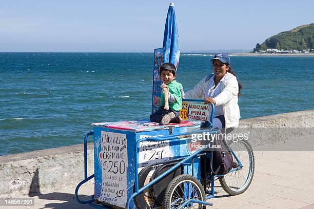 woman and daughter on bicycle ice cream cart. - puerto montt fotografías e imágenes de stock