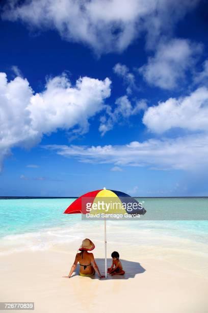 Woman and daugther on sandbank, Kaafu Atoll, Maldives