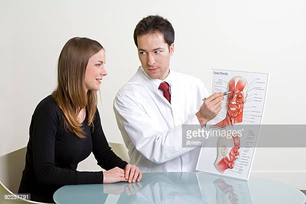 Woman and doctor planning cosmetic surgery at consultation