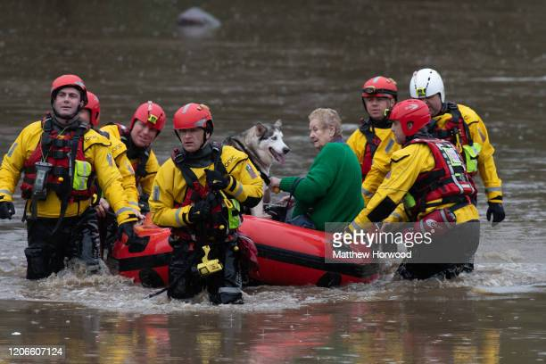 A woman and dog are rescued from a property on Oxford Street on February 16 2020 in Nantgarw Wales The Met Office have issued a red weather warning...
