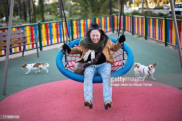 Woman and dog in playfield
