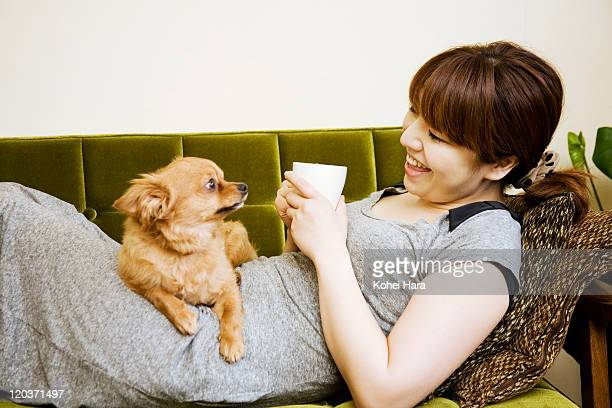 woman and dog in the room