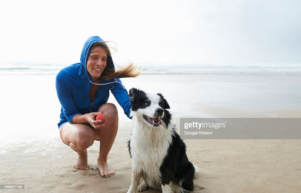Woman and dog on beach. : Stock Photo
