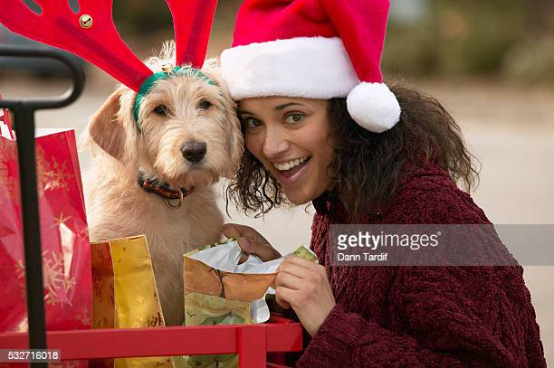 woman and dog ready for christmas - african american christmas images stock pictures, royalty-free photos & images