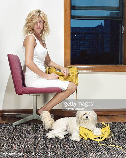 Woman and dog with matching handbags, portrait
