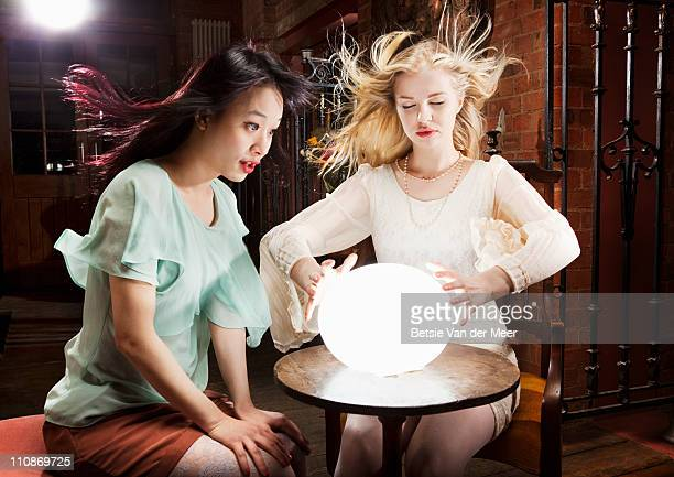 woman and fortuneteller with crystal ball. - paranormal stock pictures, royalty-free photos & images