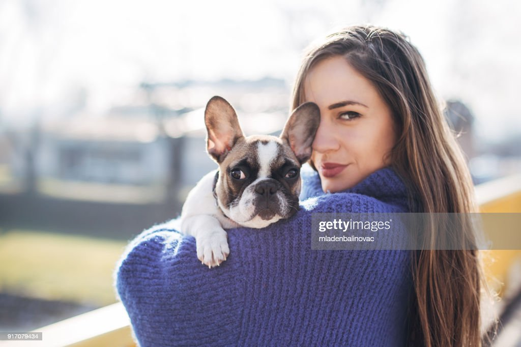 Woman and French bulldog : Stock Photo