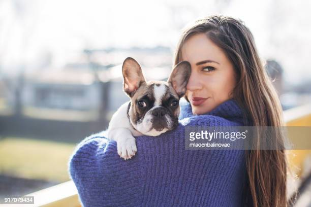 woman and french bulldog - petite teen girl stock photos and pictures