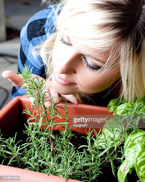 Woman and fresh herbs
