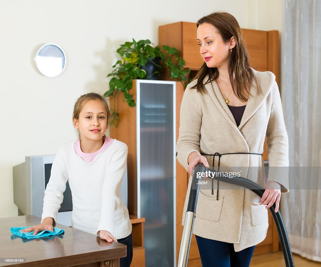 Woman and girl cleaning at home : Stock Photo