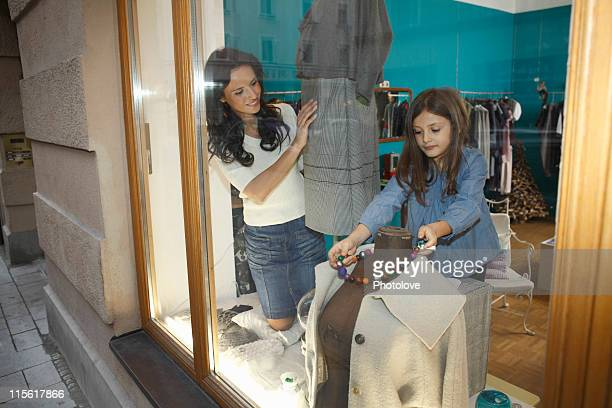 woman and girl dressing shop mannequin