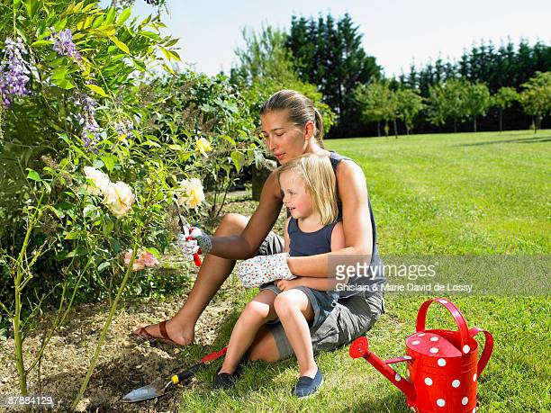 Woman and girl gardening