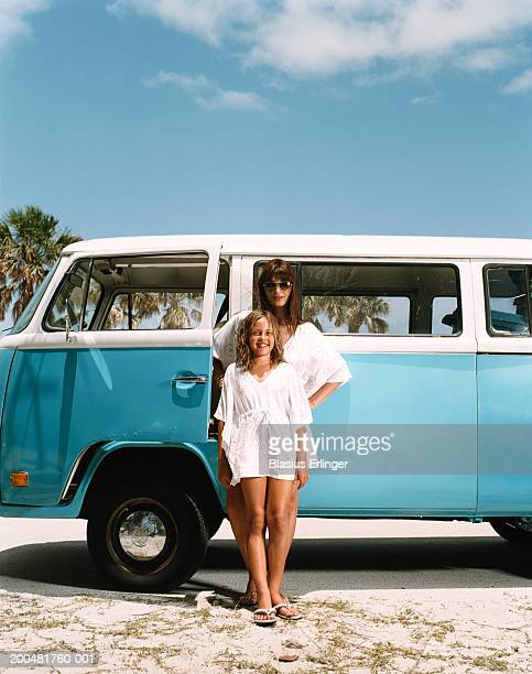 woman and girl (7-9) in front of van, portrait - blasius erlinger stock pictures, royalty-free photos & images