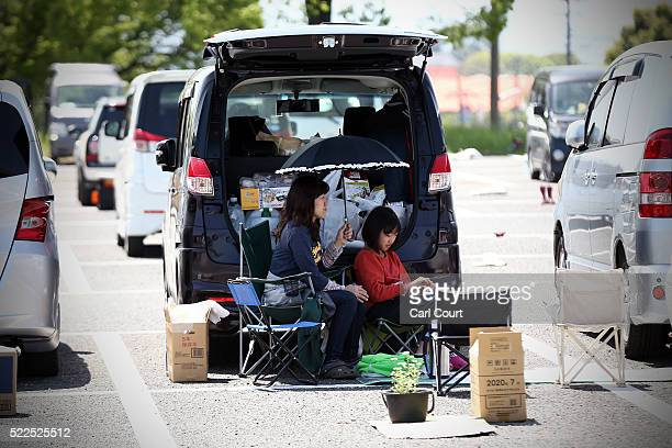 A woman and girl shelter at an evacuation centre following an earthquake on April 20 2016 in Mashiki near Kumamoto Japan As of April 20 48 people...
