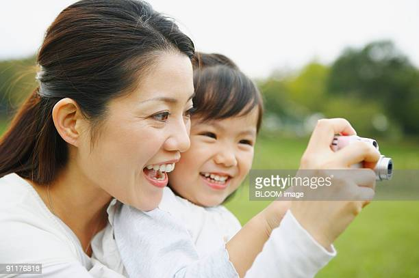 Woman and girl taking picture