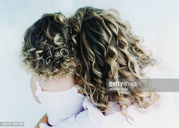 Woman and Girl with Curly Hair