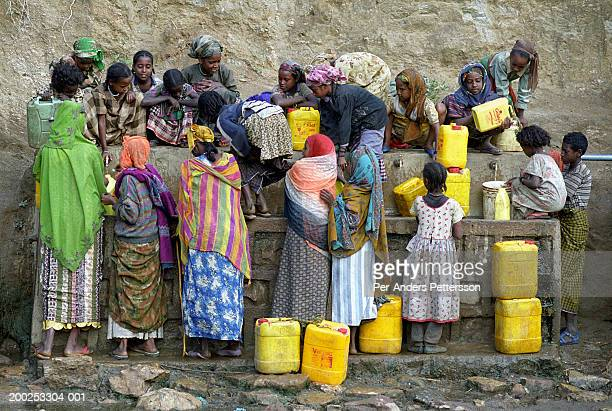 Woman and girls fetch water in rural village in Erer Valley, Ethiopia