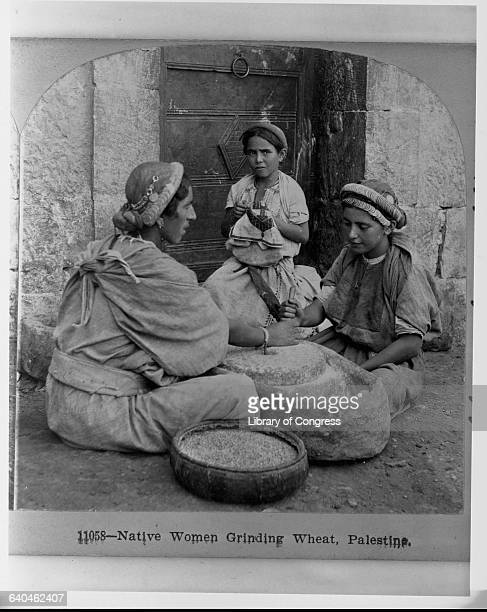 Woman and Girls Grinding Wheat
