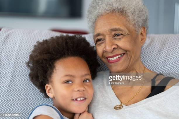 woman and granddaughter bonding - fat granny stock pictures, royalty-free photos & images