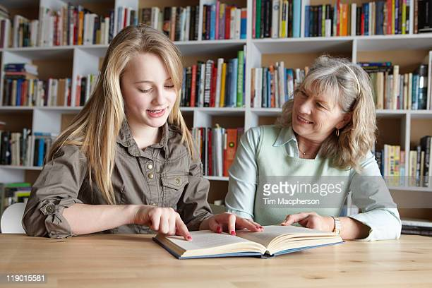 Woman and granddaughter reading together