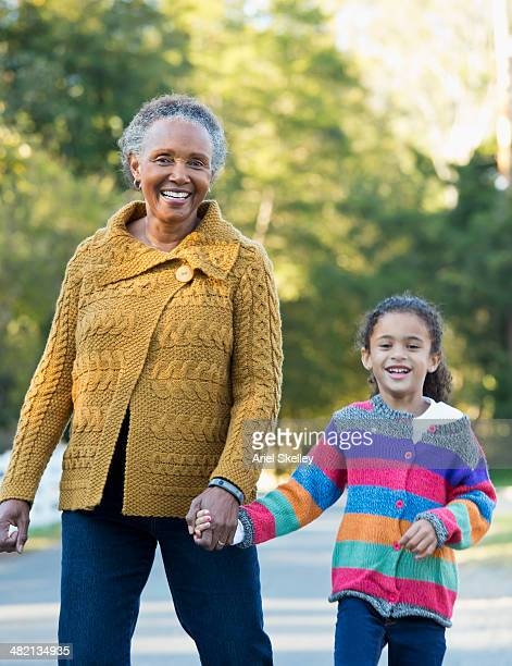 Woman and granddaughter walking outdoors