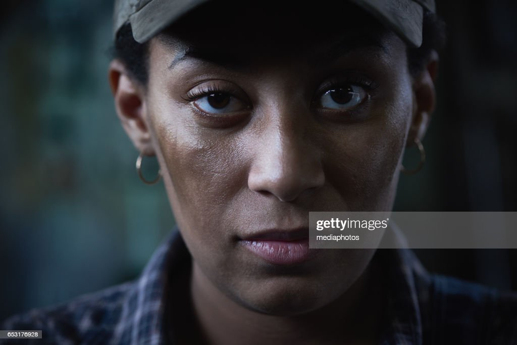 Woman and grit : Stock Photo