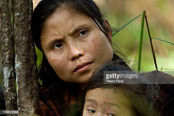 A woman and her child at a displaced people community in the jungle of the Northern Karen State For years the Burmese army has been leading ethnic...