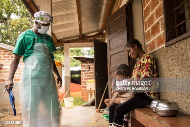 A woman and her child both infected with monkeypox await treatment at the quarantine area of the centre of the International medical NGO Doctors...