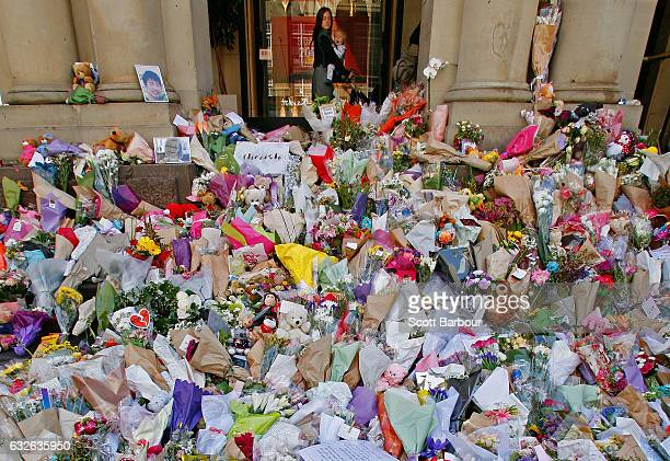 A woman and her child look at floral tributes at Bourke St Mall for victims of the Bourke Street Mall Attack on January 25 2017 in Melbourne...