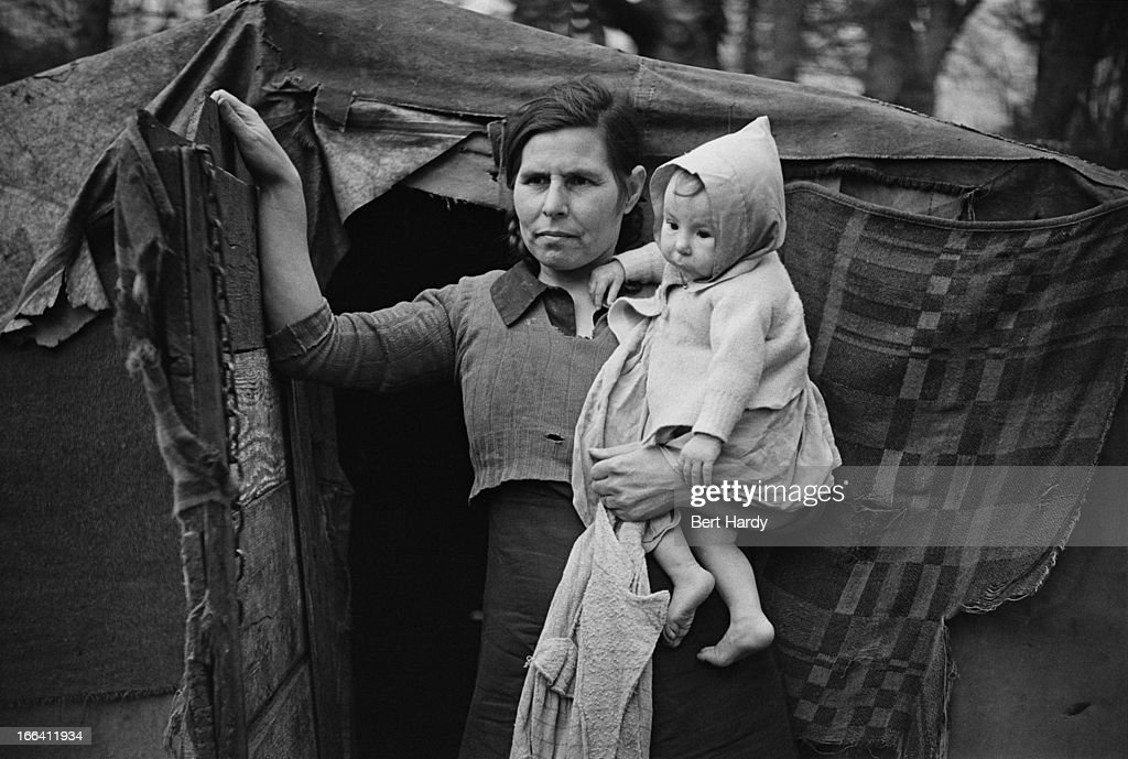 A woman and her child outside the tent where they live in the New Forest  sc 1 st  Getty Images & New Forest Tent Dwellers Pictures | Getty Images