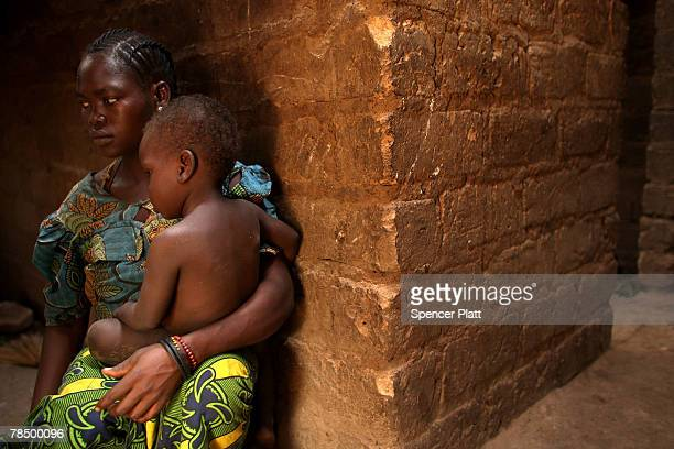 Woman and her child sit in their home December 15, 2007 in Ouaki 1 in the northern Central African Republic. Central African Republic is one of the...