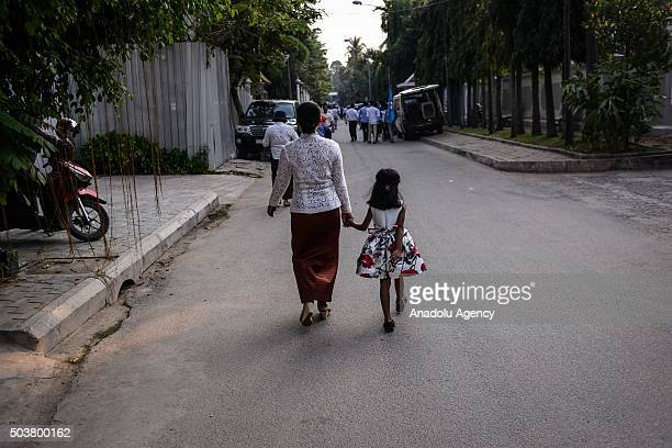 Woman and her child walk to the headquarters of the Cambodian People's Party to celebrate Victory Against Genocide Day in Phnom Penh, Cambodia, on...