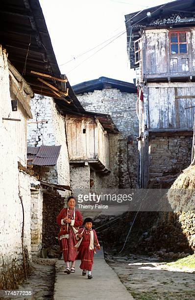 A woman and her daughter from the Monpa ethnic the main ethnic group in the region walk through the alleys of the Tawang monastery