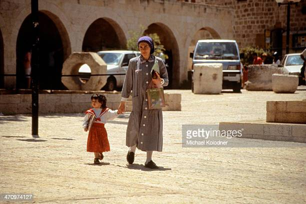 CONTENT] A woman and her daughter walk through Old Jerusalem's Jewish Quarter as the sabbath approaches The family is the most basic social unit...