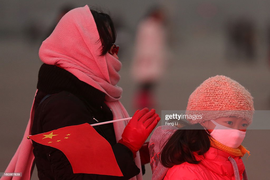 A woman and her daughter wearing the mask walk on the Tiananmen Square during severe pollution on January 30, 2013 in Beijing, China. The fourth round of heavy smog to hit Beijing in one month has sent more people to the hospital with respiratory illnesses and prompted calls for legislation to curb pollution. The haze choking many Chinese cities covers a total area of 1.3 million square kilometers, the China's Ministry of Environmental Protection said Tuesday.