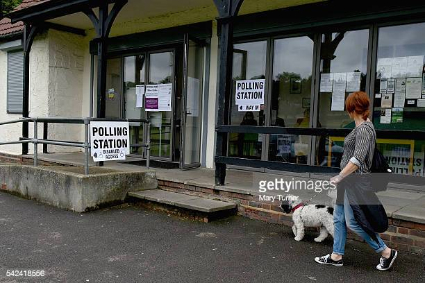 A woman and her dog Archie head to their local polling station to register her vote in the EU referendum in Farthing Downs park on June 23 2016 in...